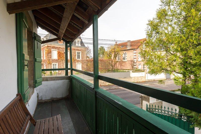 Balcony-veranda overlooking Colbert Street and the large courtyard of the cooperage