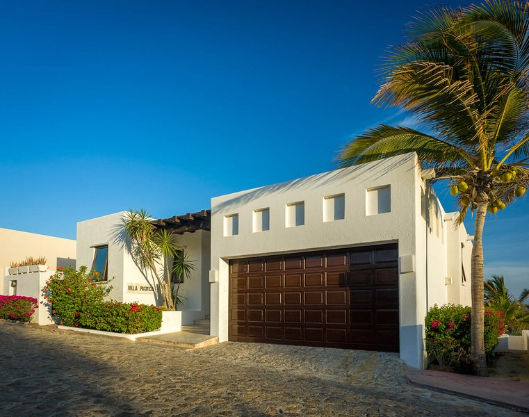 Be mesmerized by plenty of tall palm trees when you first arrive at Villa Pacifica