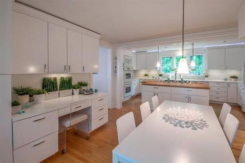 Bright white eat in kitchen with top notch appliances and everything needed for entertaining