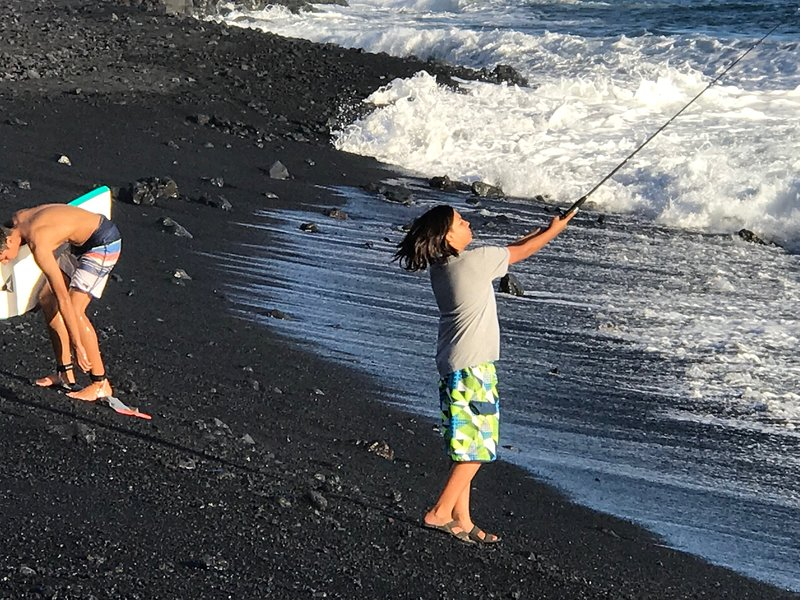 Kids fishing off the beach at Pohoiki