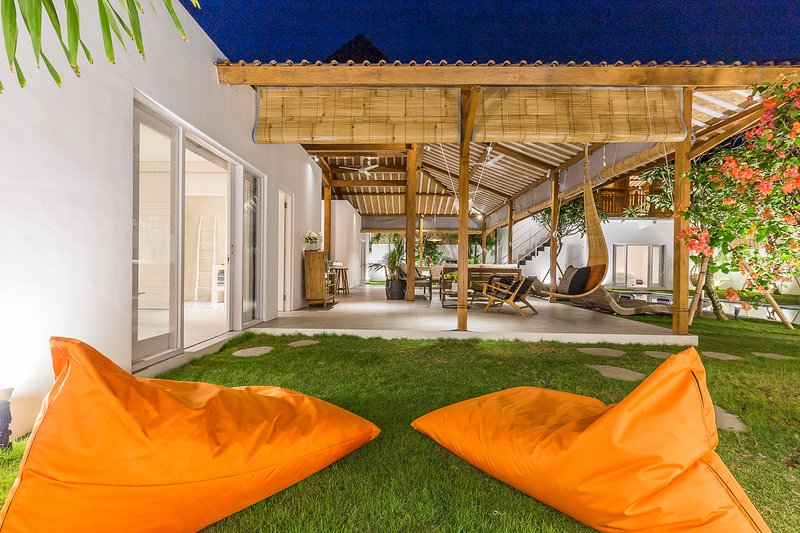 living area in the joglo (main building) / view from the lawn and the bean bags