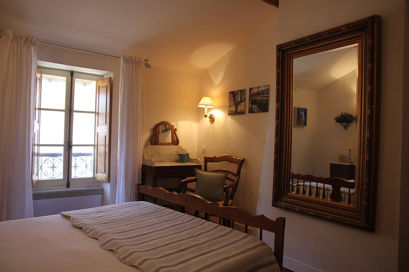 Enjoy the comfort - plus lighting options, Provençal antique furnishings, and charming window view.