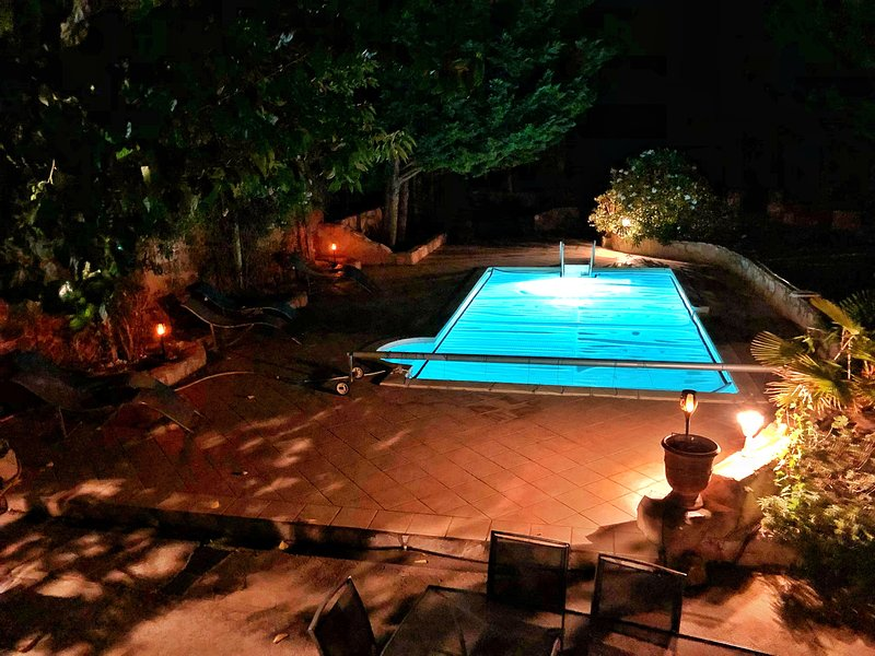 Pool and terrace lights make for a lovely atmosphere at night
