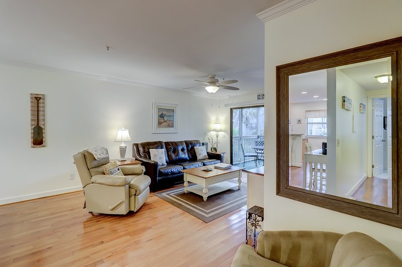 Spacious living area features with beautiful hardwood floors. Very relaxing!