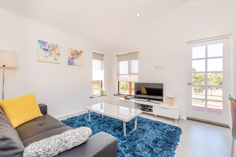 Cabaña sala de estar con TV vía satélite