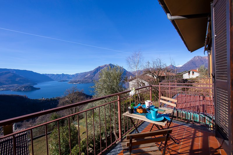 Romantic balcony with breathtaking view of the lake