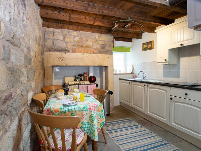 Well equipped kitchen and dining area