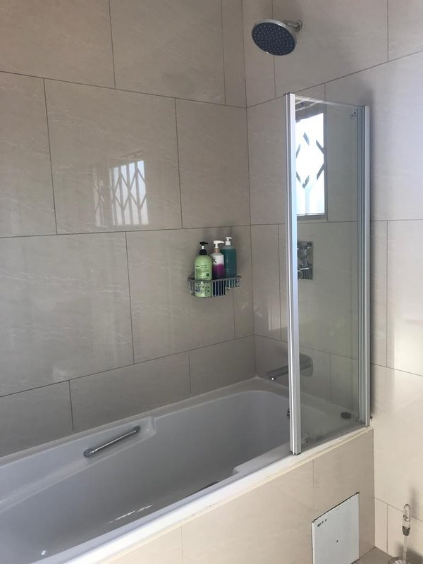 Bathroom to Bedroom 2 with shower and bath tub