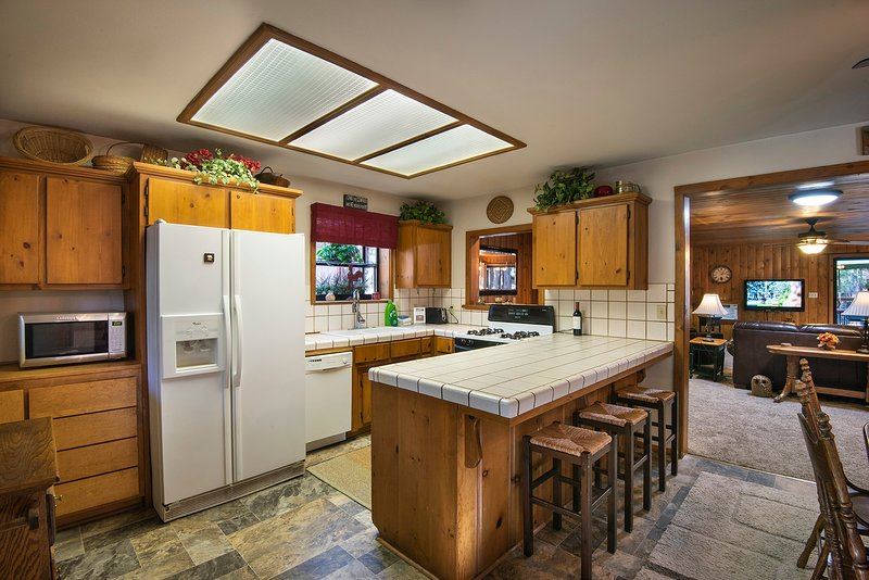 Fully equipped kitchen with additional seating at bar for 3