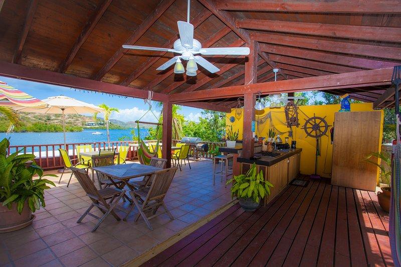 Outdoor kitchen terrace with bar, bbq, hammocks..