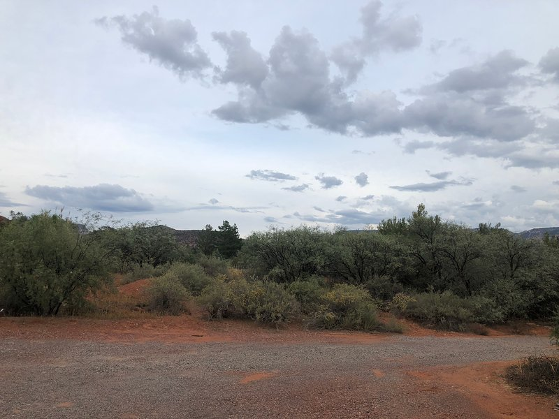 The view to the east provides glimpses of the Mogollon Rim and beautiful natural scenery.