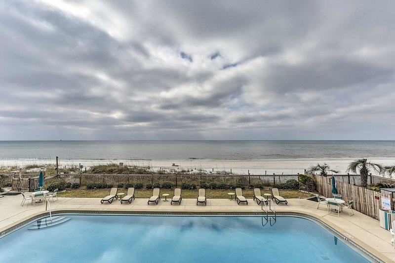 Unwind in this beachfront 2-bedroom, 2-bathroom vacation rental condo for 7.