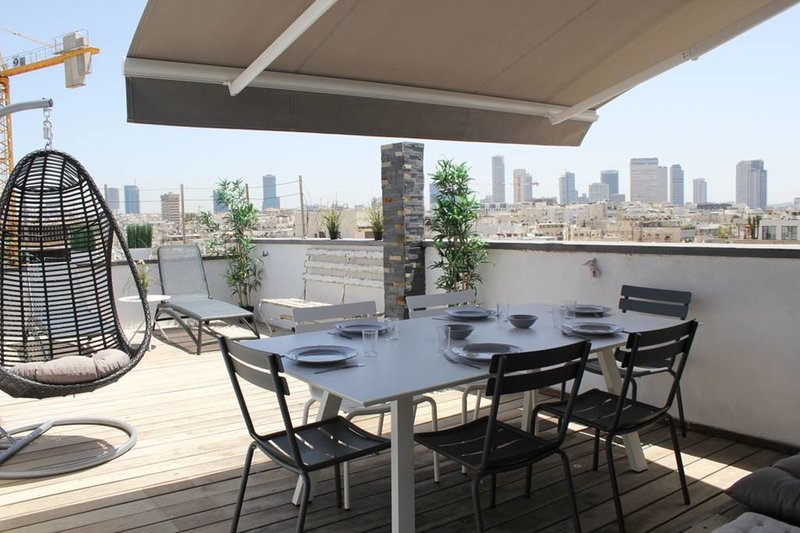 great terrasse to have dinner or lunch outside with shadow curtain