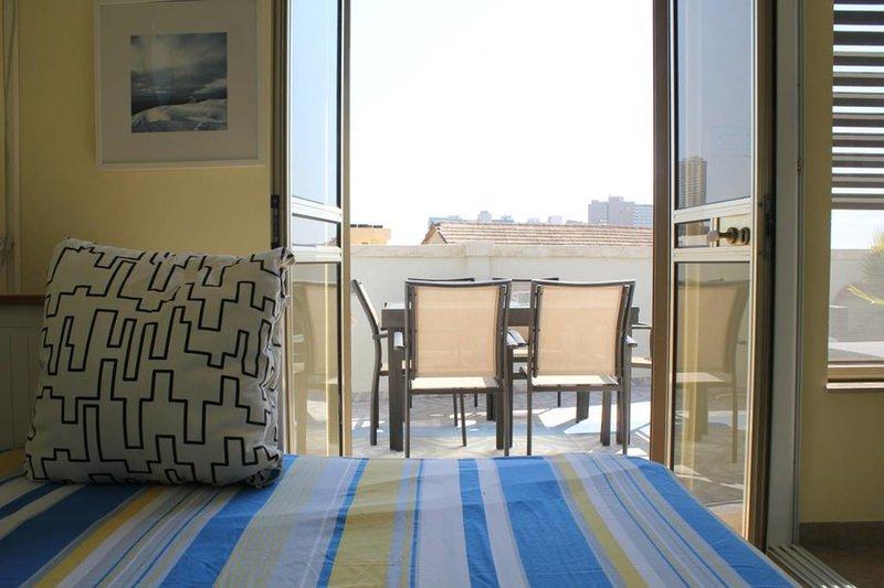 Allongez-vous sur votre lit et profitez de la terrasse en même temps