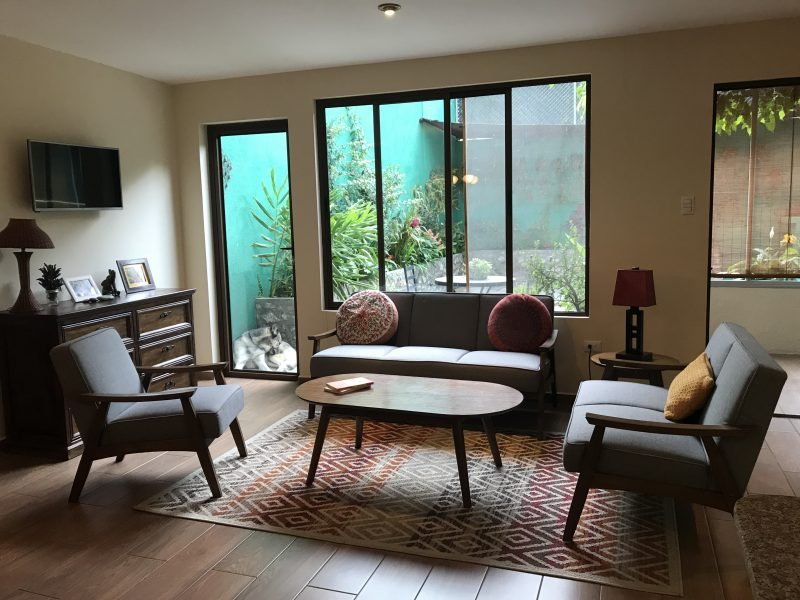 Living room and access to private garden patio