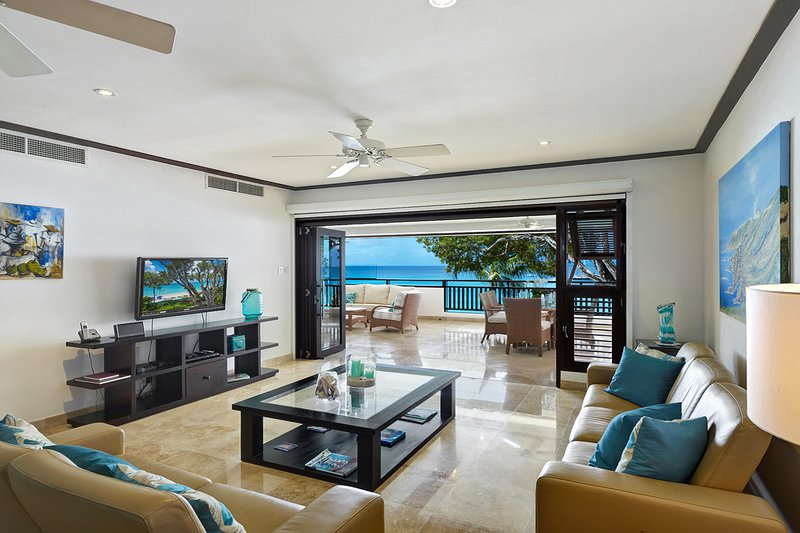 Coral Cove 7-Sunset - Open plan living area with a cable TV and Wi-Fi throughout leads onto the verandah