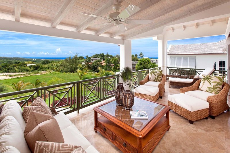 Comfortable patio with views of the Caribbean sea beyond