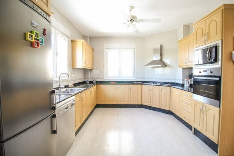 Large, bright, modern Kitchen.  Fully fitted and kitted. Marble counter top. Two windows. Gas hob.