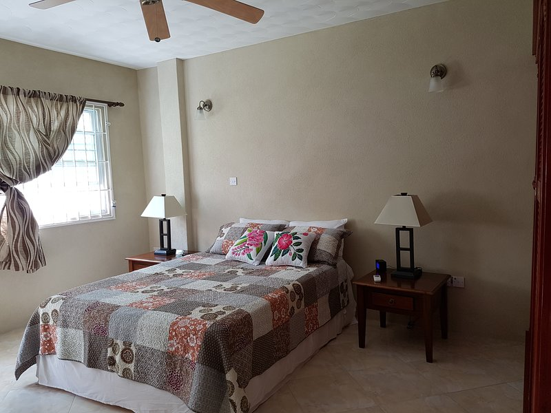 Bedroom with A/C and ceiling fan