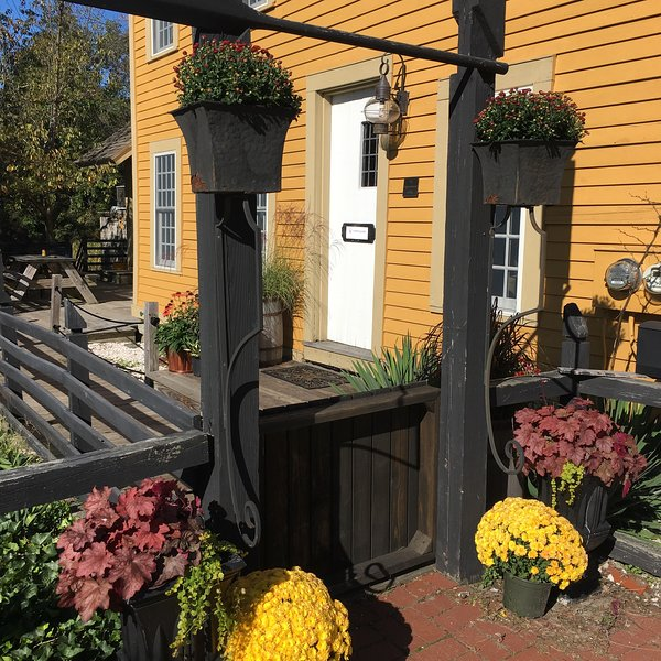 Warm and inviting entry to a historic mill - gorgeous seasonal plantings