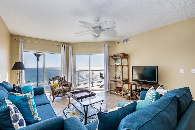 Living room w/access to private balcony
