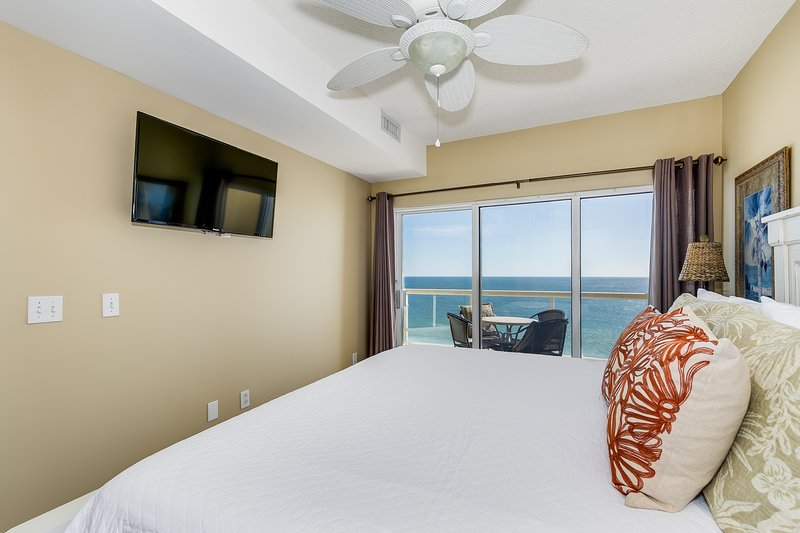 Master bedroom w/access to private balcony