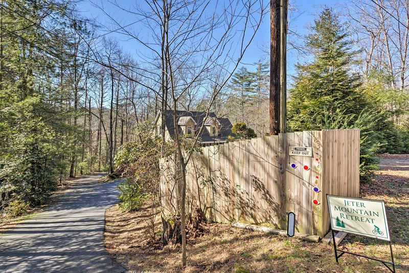 The 'Jeter Mountain Retreat' sign is visible from the road!