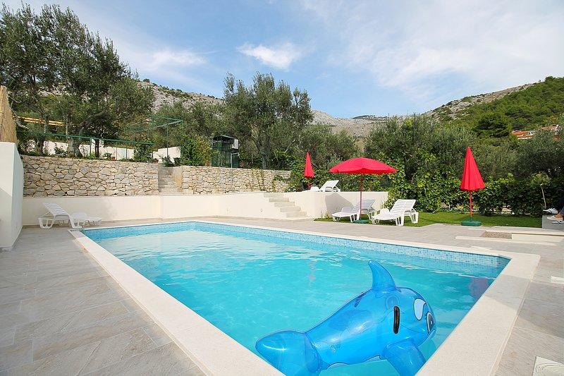 Villa Marietta con piscina climatizada y sauna, máximo 12 personas
