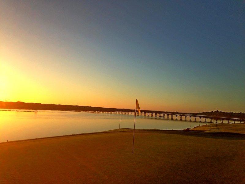 The sun sets over Quinta do Lago beach, the Ria Formosa and San Lorenzo Golf Course.