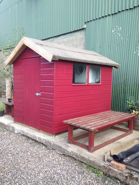 Red bike shed for guest use