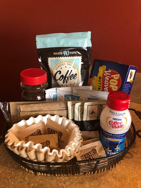Your welcome basket awaits. Coffee, hot chocolate, bottled water, and snacks await you!
