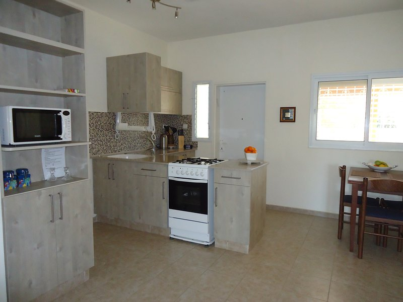 Open space kitchen and dining area, fully equiped