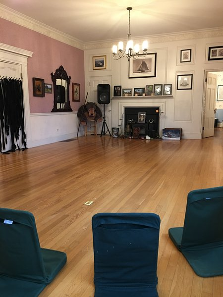 Great room with flatscreen TV, music and 24 yoga chairs