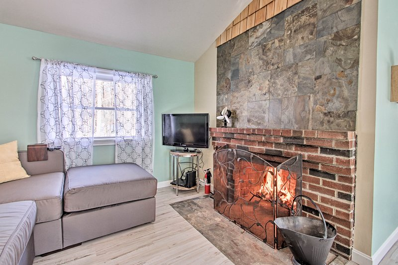 Cozy up by the fireplace at this vacation rental home.