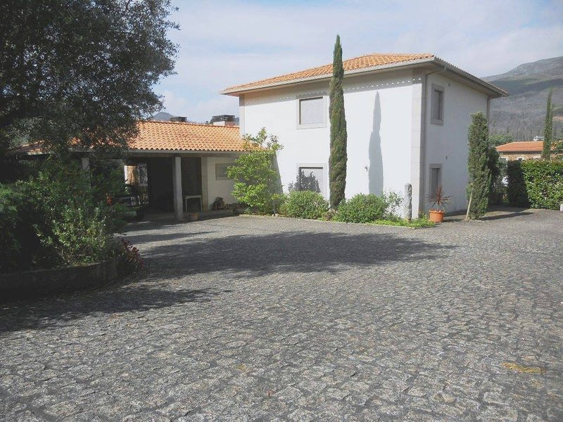 Entrance to the house - many places for cars