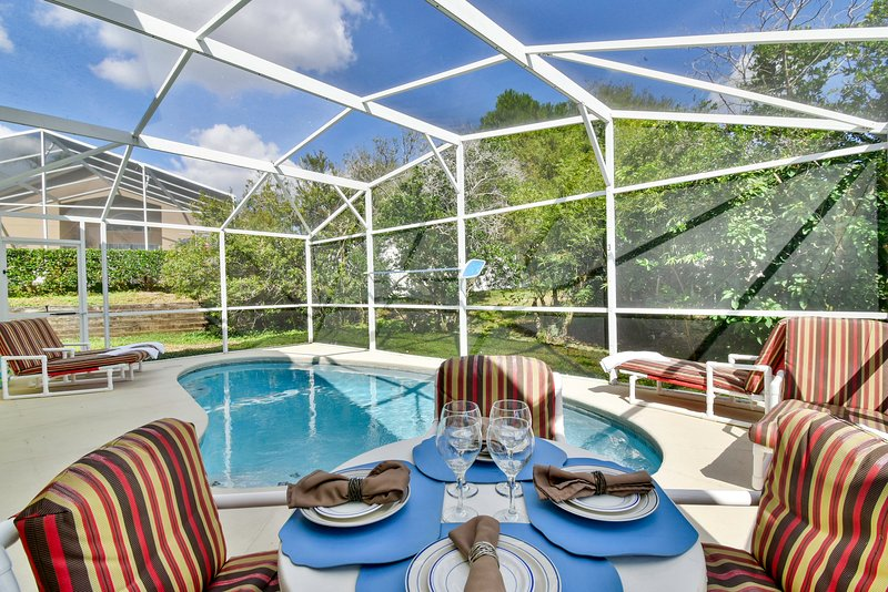 Patio table and landscaped pool