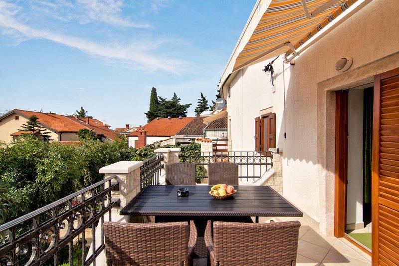 Chair,Furniture,Balcony,Patio,Railing