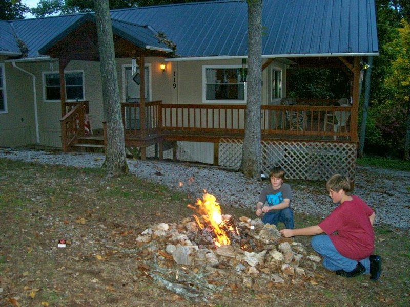 Kids enjoy a campfire and marshmallows
