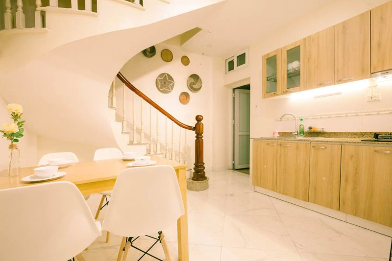 Spacious kitchen, living and dining area for lovely energetic breakfast. Make you feel like home!