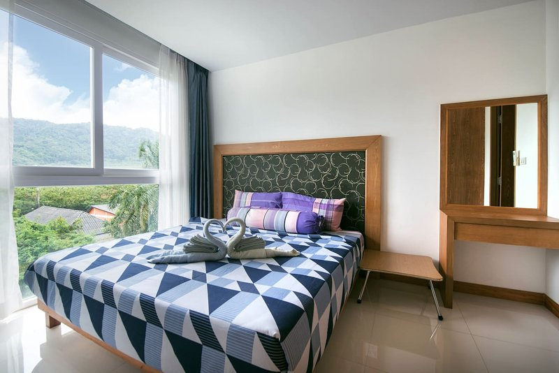 Slaapkamer met uitzicht op de bergen