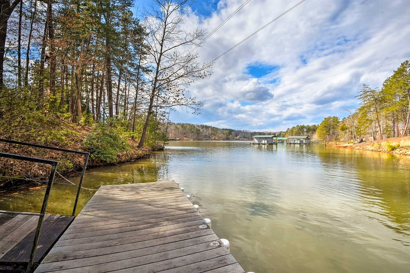 The home is only steps away from a private swimming dock on the water's edge!