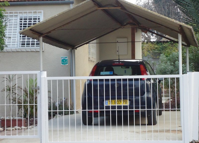 Secured gated parking with additional parking space in front of the gate.