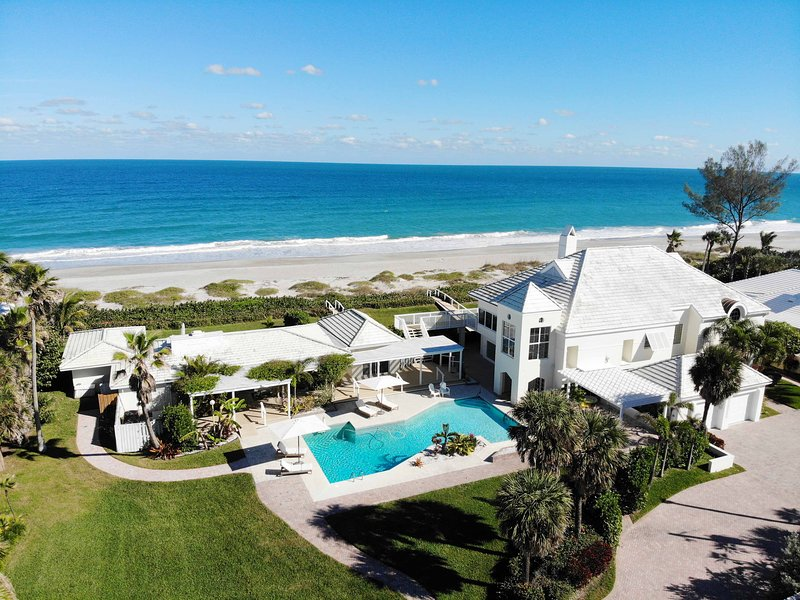 Two-Home Direct oceanfront compound with cabana bar and pool.