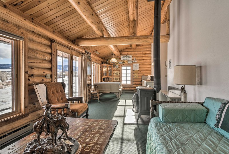 This vacation rental boasts a cozy living space inspired by forestry cabins.