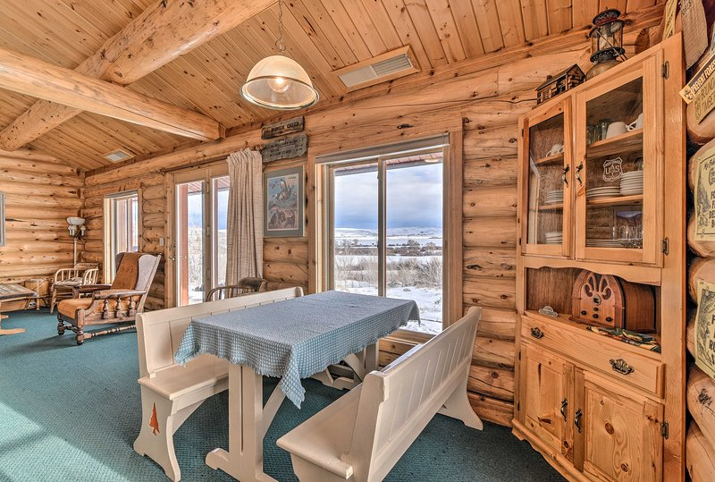 A secluded getaway awaits at this modern log cabin outside Encampment, WY!