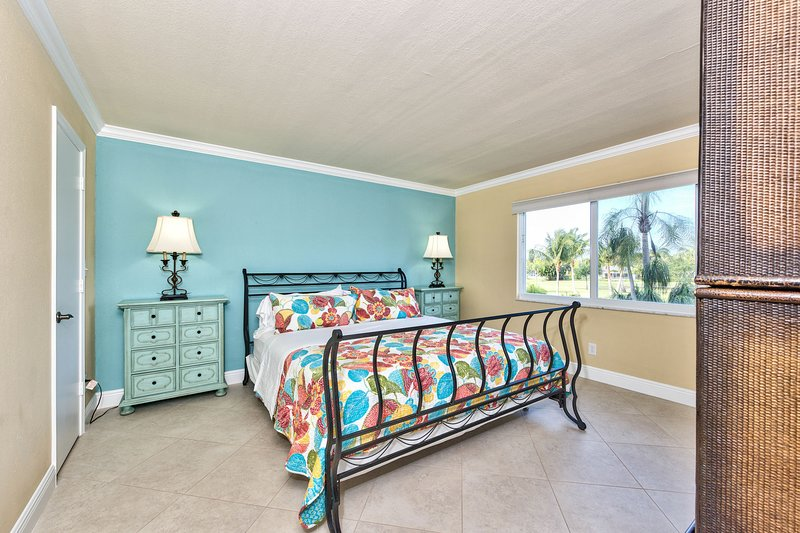Master Bedroom with King Size Bed; Golf Views and Flat Screen TV! Private Entrance to Lanai Area!