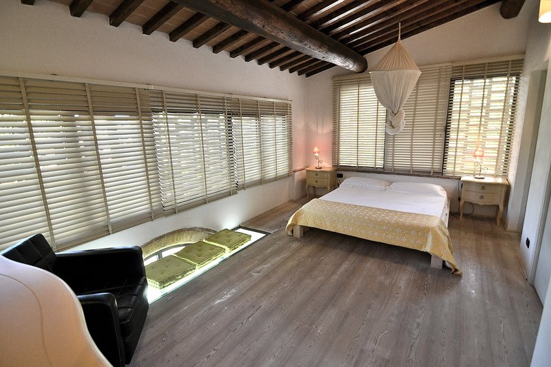 The master bedroom of your villa with big bathroom ensuite and jacuzzi