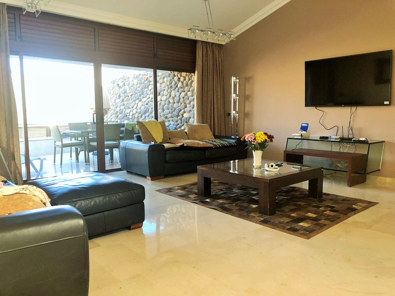 Sitting room with tv and also WIFI and every room has air conditioning.
