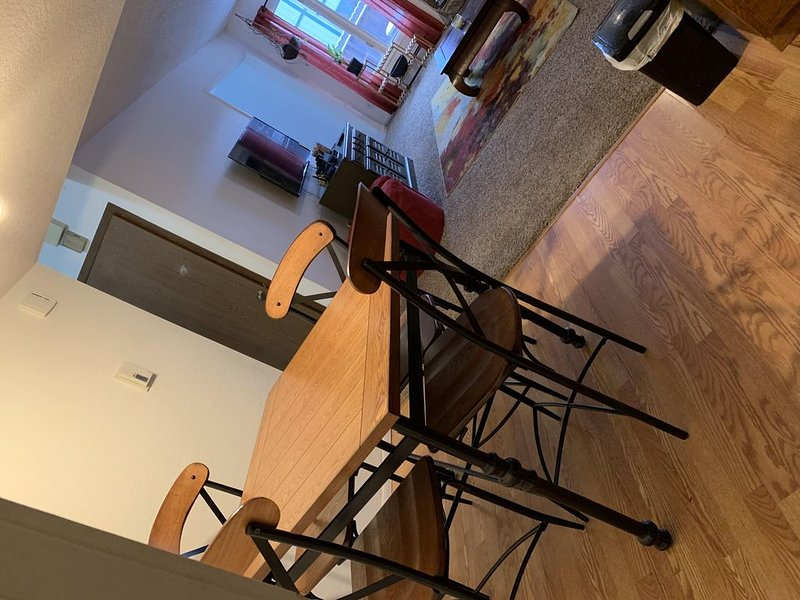 Dining room seats 4, bar top seats 3