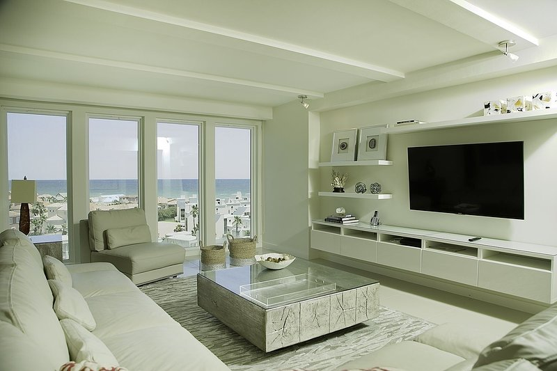 White leather sofas and a nice view of the ocean are perfect to sit back and relax.